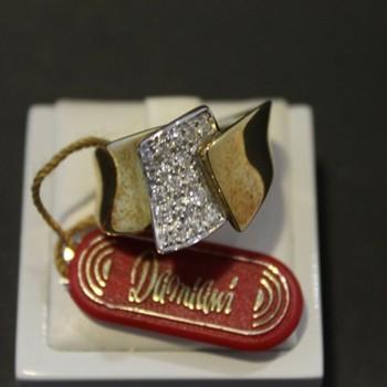 Anello Damiani oro con diamante 0,44 ct.